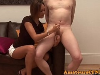 CFNM amateur wanks cock on the couch