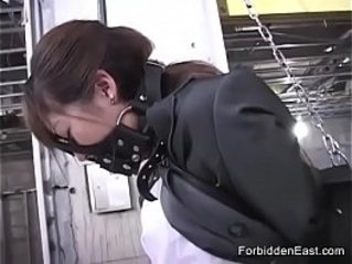 Submissive Japanese Business Woman In Leather Bound And Masked