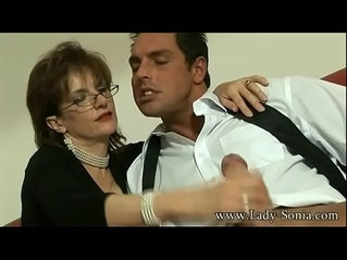 British Lady sucks a huge cock and gets her face covered in cum