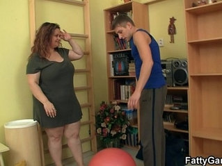 Cute fatty seduces fitness trainer