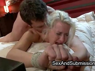 Tied blonde babe fucks in bed from behind by stiff dick