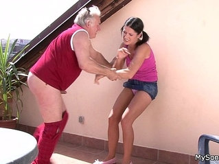 Older man fucking younger woman from behind